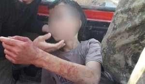Кадър от видеото, показващо обезглавяването на 12-годишно дете
