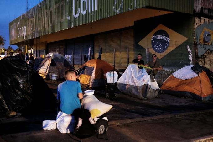 Палатки на венесуелски преселници м бразилския граничен град Пакараима. Снимка: exame