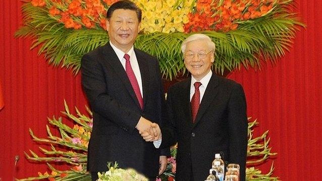 Си Дзинпин и Нгуен Фу Чонг при една от поредните им срещи. Снимка: Nhan Dan