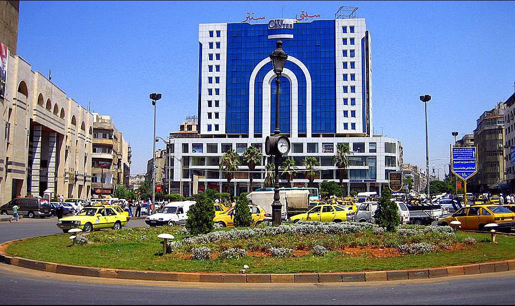 Площадът със стария часовник в град Хомс преди войната. Снимка: архив на авторката