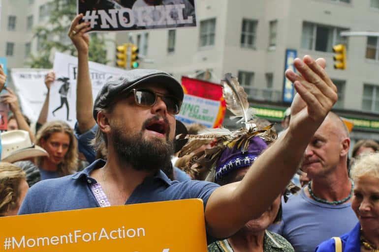 Леонардо ди Каприо по време на демонстрация в защита на околната среда през 2014 г.