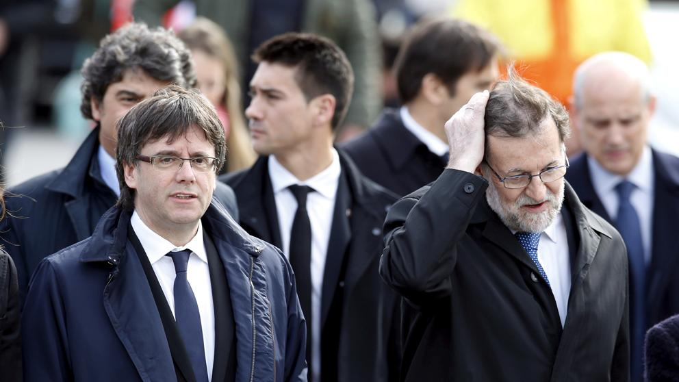 Карлес Пучдемон и Мариано Рахой на архивен кадър. Снимка: La Vanguardia