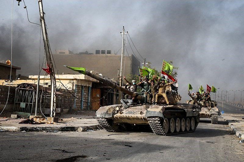 """Бойци от """"Хашд ал Шааби"""" след изтласкването на ИДИЛ от град Фалуджа, 2018 г. Източник: Wikimedia Commons"""