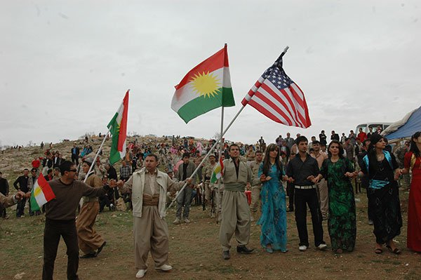 Screenshot_2019-10-08 81416_Local_citizens_wave_Kurdish_and_American_flags_during_the_Kurdish_regional_government_new_years[...]