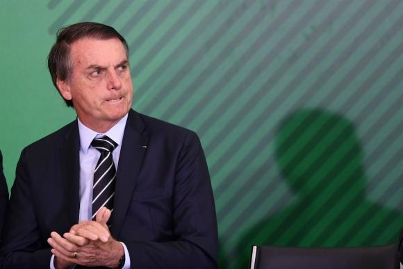 Болсонаро е известен с агресивния си език и поведение особено срещу журналистите. Снимка: lapagina.com.sv