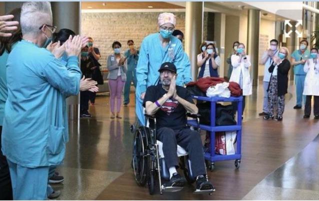 Лекарите, изпращат с аплодисменти Майкъл Флор, който дотогава е най-дълго хоспитализираният пациент с коронавирус. След това болницата му праща сметка за над един милион долара. Източник: Seattle Times