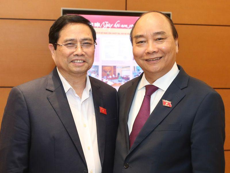 Новите премиер и президент на Виетнам - Фам Мин Чин (вляво) и Нгуен Суан Фук. Снимка: thanhnien.vn