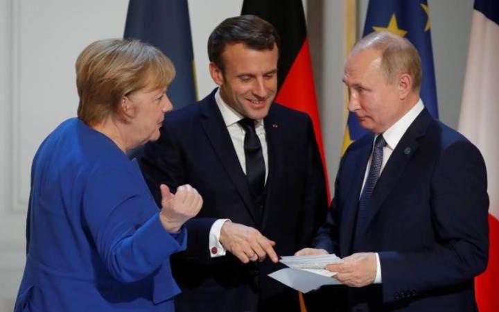 Ще се съберат ли пак скоро зедно Меркел, Макрон и Путин на среща на върха ЕС-Русия? Снимка: EFE