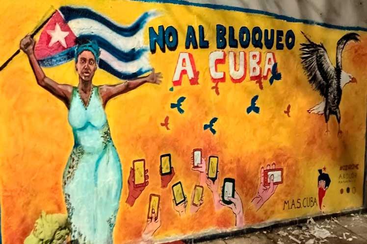 Стенопис в Ла Каняда, аржентинската провинция Кордоба, зове за солидарност с Куба. Снимка: prensa-latina.cu